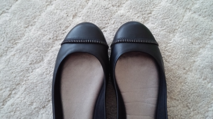 New black flats with metal accents.